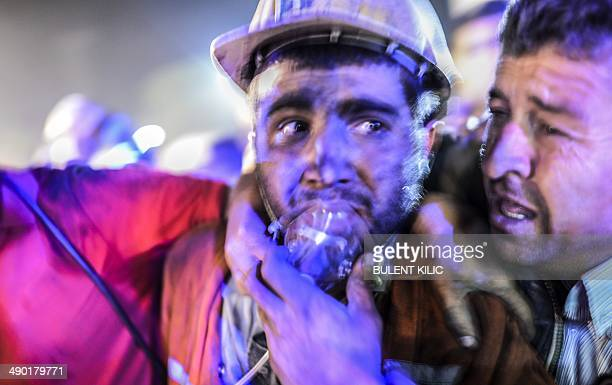 Miner celebrates with his father after an explosion on May 13, 2014 in Manisa. Four miner were killed and as many as 300 trapped after a mine...