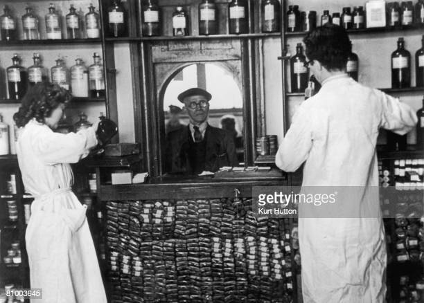 A miner collects his prescription from a pharmacy in Wales 27th April 1946 The health service in Wales provides free healthcare and medicine and was...