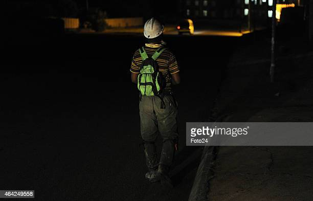 A miner during a rescue operation at Kusasalethu gold mine on February 22 2015 in Cartlonville South Africa Harmony Gold and the mineral resources...