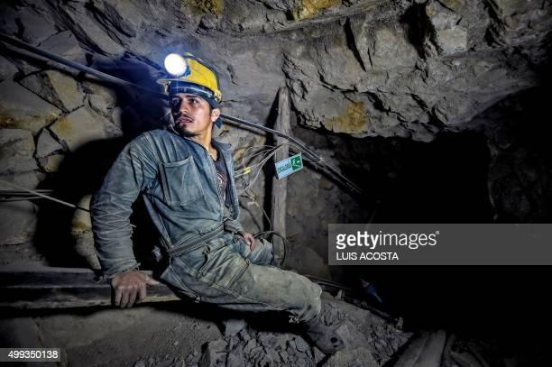 Miner Edison Rosero gets ready for a 100mdescent at 'La Corte' gold mine in La Llanada Narino department on October 20 2015 La Llanada miners extract...