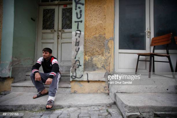 Miner Erdal Bicak who survived the mine accident in Soma, sits looking dejected in Turkey's western province of Manisa May 17, 2014. Manisa...