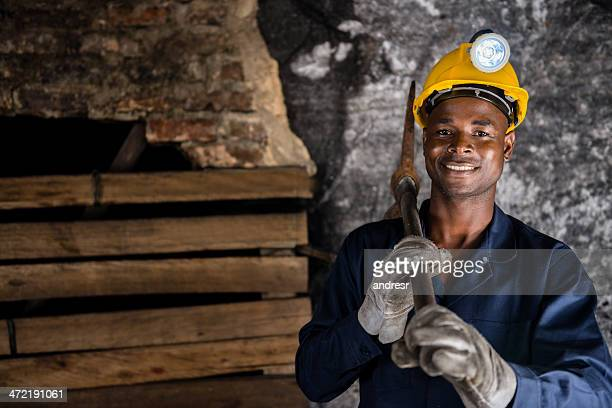 Miner holding a pick axe