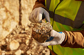 Miner Holding Chunk of Mineral