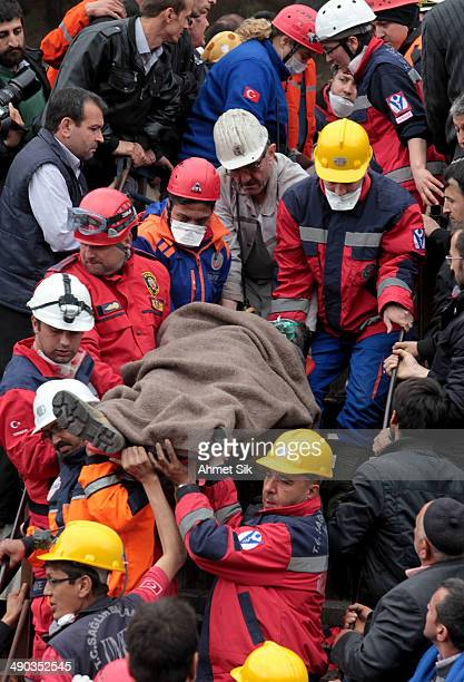 Miner is carried to an ambulance by rescue teams after a coal mine explosion, on May 14, 2014 in Soma, Manisa, Turkey. Rescuers pulled more dead and...