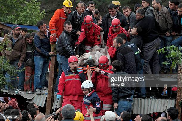 A miner is carried to an ambulance by rescue teams after a coal mine explosion on May 14 2014 in Soma Manisa Turkey Rescuers pulled more dead and...