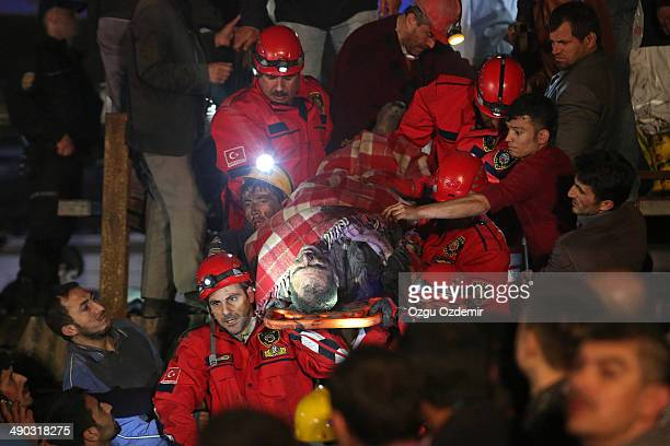 Miner is carried to an ambulance by rescue workers from the coal mine on May 14, 2014 in Soma, Manisa, Turkey. An explosion and fire in the coal mine...