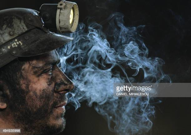 A miner is seen at the end of his last shift at the coal mine in the Romanian city of Petrila on October 30 2015 Petrila the oldest coal mine in...