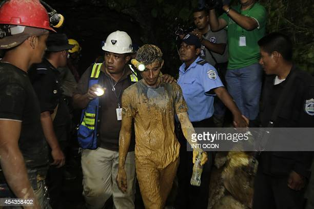 A miner is taken to a hospital after being rescued by members of SINAPRED during a rescue operation to reach a group of miners trapped in a gold mine...