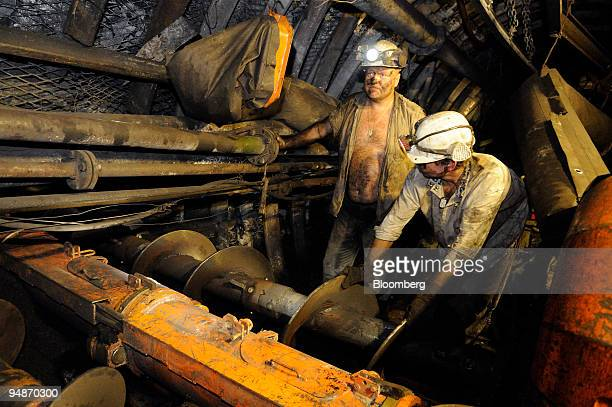 Miner Jaroslav Horak left works with Jiri Gasper to operate a seal drilling machine at the Paskov coal mine owned by OKD AS in Staric Czech Republic...