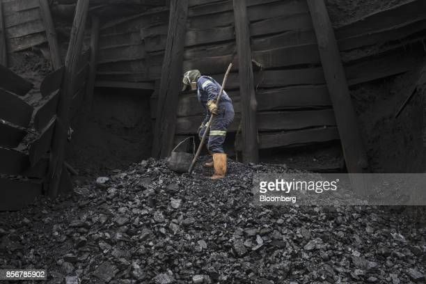 A miner manually culls rocks and stones from coal in Cucunuba Cundinamarca Department Colombia on Saturday July 2017 Colombia is set to produce a...