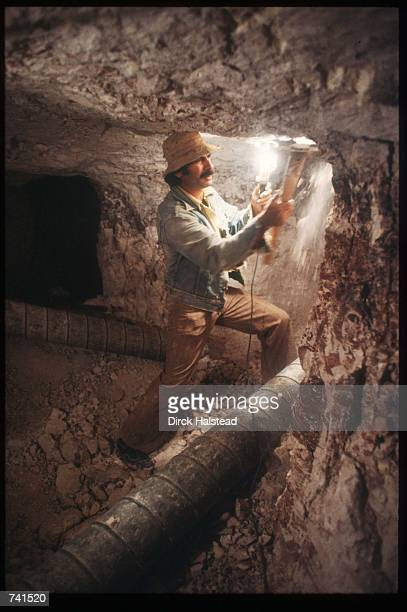 Miner Mario Kovacevic sticks the wall with a pickaxe June 6 1981 in Australia Coober Pedy is recognized as the largest producer of opal in the world...