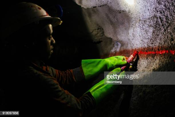 A miner marks a passageway wall inside a mine shaft at the Northam Platinum Ltd Booysendal platinum mine located outside the town of Lydenburg in...