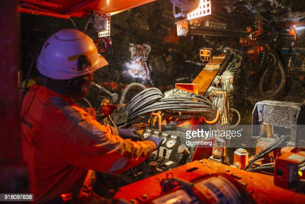 A miner operates drilling machinery in a mine shaft at the Northam Platinum Ltd Booysendal platinum mine outside the town of Lydenburg in Mpumalanga...