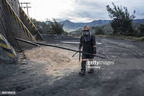 A miner passes in front of a coal furnace in Cucunuba Cundinamarca Department Colombia on Saturday July 2017 Colombia is set to produce a record of...