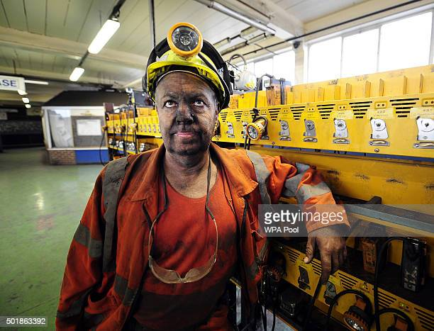 Miner Phil Kelsey, who has worked at Kellingley Colliery for 32 years, leaves the lamp room as the last shift finishes on the final day of production...