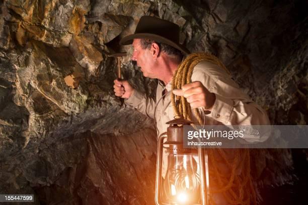 Miner picking for gold