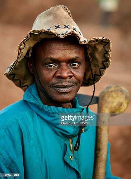 A miner poses for the photographer prior to start his day's work 28 March 2013 at the 7/7 diamond mining site near an Angolan village not far from...