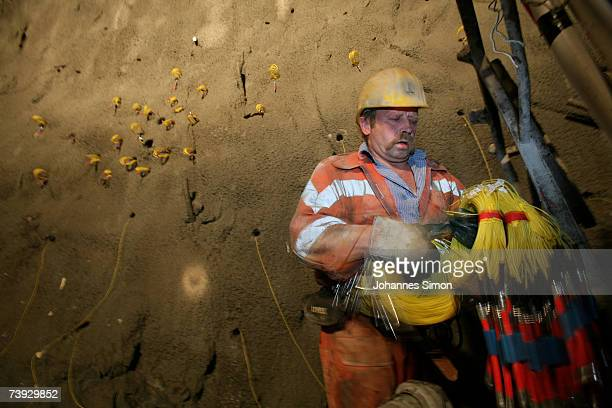 A miner prepares a stone wall for detonation at the construction site for the Gotthard Base Tunnel on April 19 2007 near Sedrun Switzerland Deep...