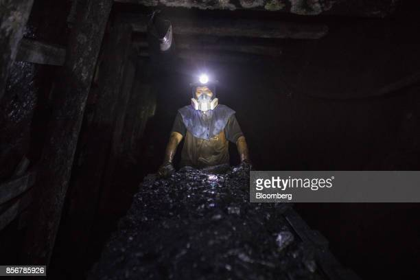 A miner pushes a a wagon of coal inside a mine in Cucunuba Cundinamarca Department Colombia on Friday July 28 2017 Colombia is set to produce a...