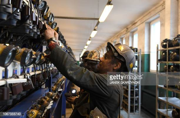 A miner puts away his equipment after a night shift at the shaft at the Knurow mine on November 23 2018 in Knurow in Poland's southern mining region...
