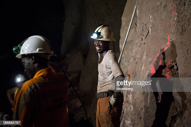 A miner reacts while working with colleagues on the digging floor at the Yalea underground gold mine part of the LouloGounkoto gold mine complex...