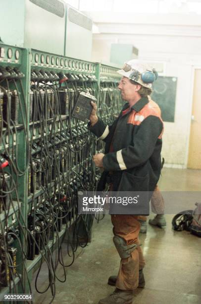 A miner returns his lamp to the lamp room for the final time as the last shift at Cotgrave pit clocks off Circa 1992