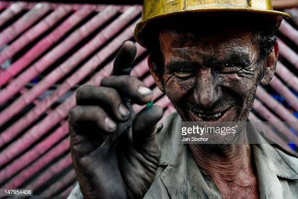 A miner shows a rough emerald found in the mine of Muzo on April 21 2006 in Muzo Colombia Despite of a persisting civil war conflict Colombia still...