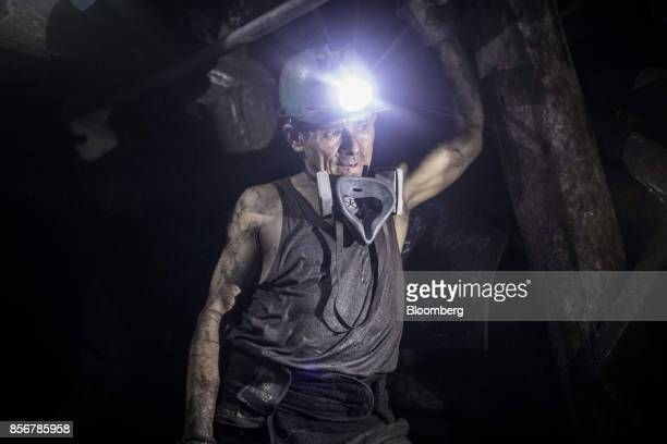 A miner stands with a headlamp on inside a coal mine in Cucunuba Cundinamarca Department Colombia on Friday July 28 2017 Colombia is set to produce a...