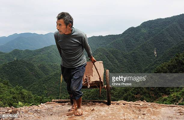 A miner suffering from silicosis labours in an abandoned gold mine trying to find gold at the Shangshan Township on August 17 2008 in Xiushui County...