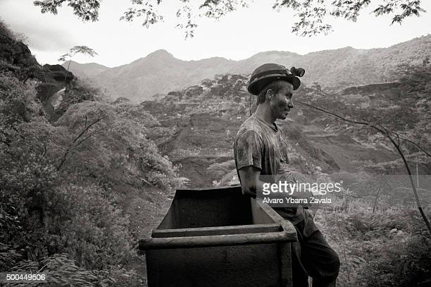 A miner takes a break at the entrance to the Millionaire mine The miners work simply for food spending 12 hours underground each day with virtually...