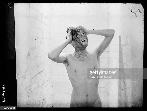 Miner taking a shower Askern Colliery South Yorkshire 18 January 1944 A miner enjoying the newly installed showers at Askern Colliery near Doncaster...