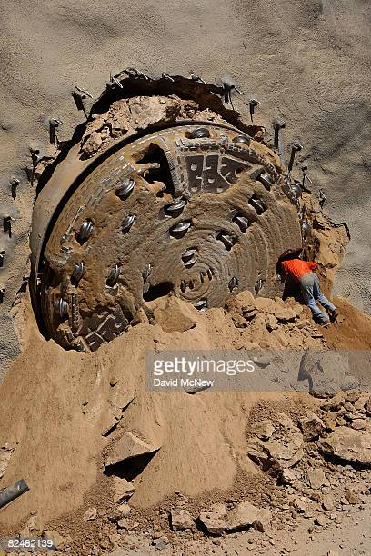 A miner talks to a fellow miner after emerging from a 450footlong tunnelboring machine upon breaking through from under the San Bernardino Mountains...