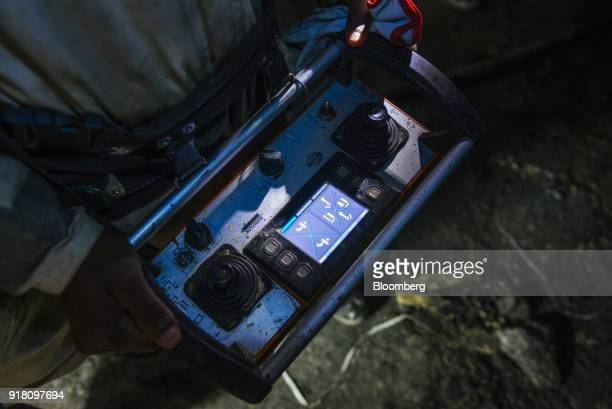 A miner uses a drilling remote control device inside the Northam Platinum Ltd Booysendal platinum mine located outside the town of Lydenburg in...