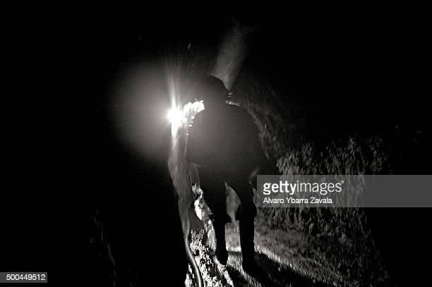 A miner walking down the Millionaire mine The miners work simply for food spending 12 hours underground each day with virtually no safety precautions...