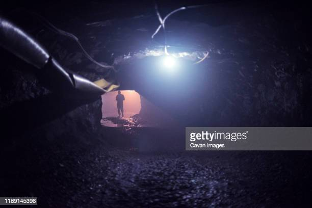 miner walking inside a quartzo mine - amethyst stock pictures, royalty-free photos & images