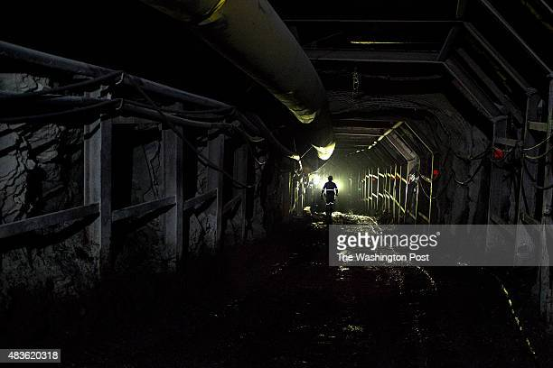 A miner walks inside an emerald mine owned by Minería Texas Colombia a USA emerald mining company in the municipality of Muzo department of Boyacá...