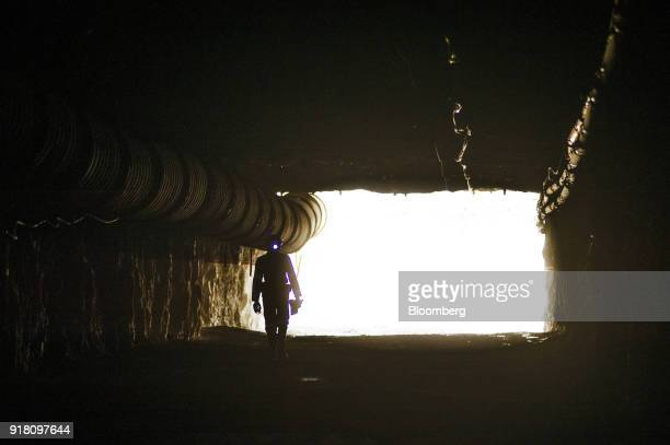 A miner walks into a mine shaft at the Northam Platinum Ltd Booysendal platinum mine located outside the town of Lydenburg in Mpumalanga South Africa...