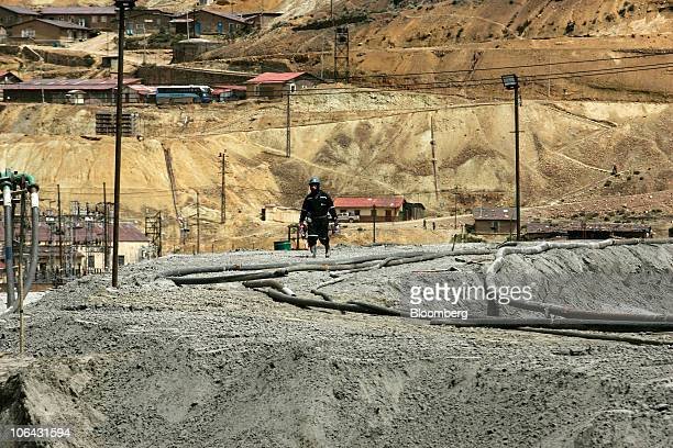 A miner walks near Morococha Peru on Monday April 5 2010 Aluminum Corp of China known as Chinalco a Chinese stateowned mining company is planning to...