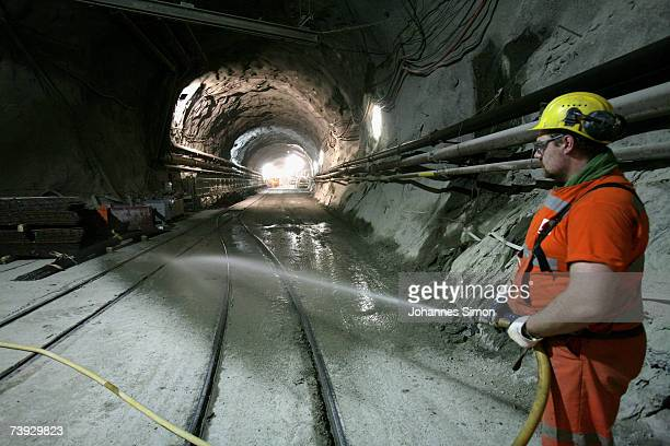 A miner waters the floor at the construction site for the Gotthard Base Tunnel on April 19 2007 near Sedrun Switzerland Deep beneath the Alps the...