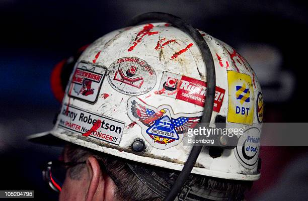 A miner wears a hard hat in Foresight Energy LLC's Pond Creek longwall coal mine in Johnson City Illinois US on Monday June 21 2010 In 2002 Foresight...