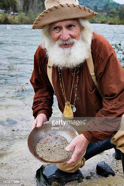 miner with gold pan - california gold rush stock photos and pictures