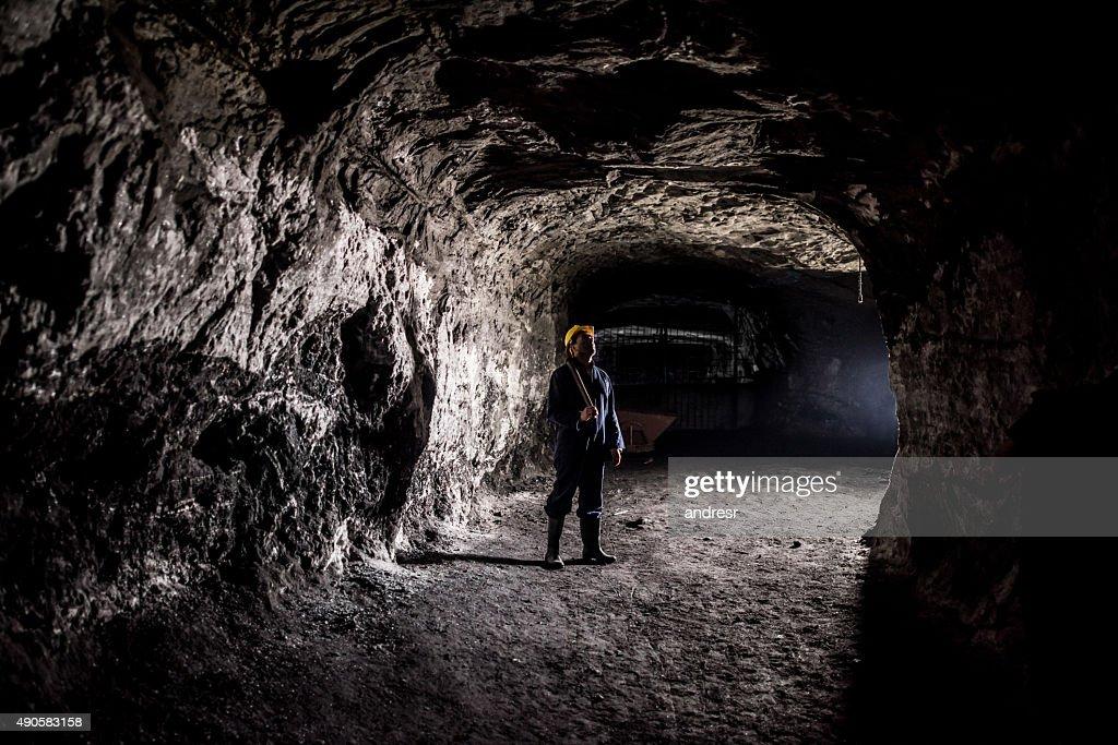 Miner working at a mine underground : Stock Photo