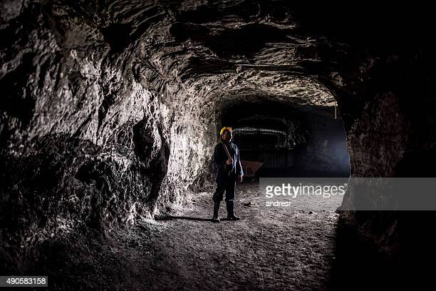 Miner working at a mine underground