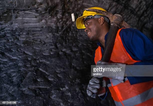 Miner working at a mine underground