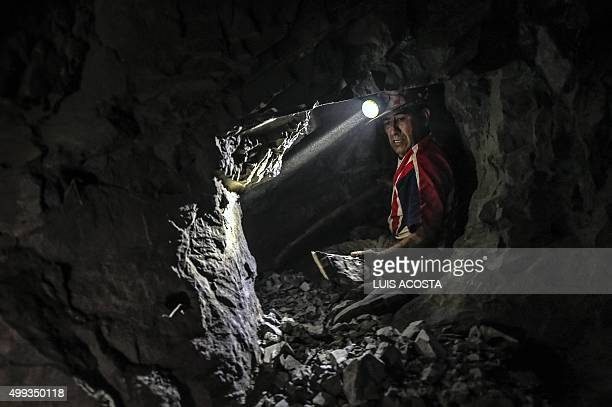 A miner works at 100 m depth at 'La Corte' gold mine in La Llanada Narino department on October 20 2015 La Llanada miners extract ethical or...