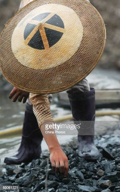 A miner works at a privately owned coal mine on June 12 2005 in Loudi Hunan Province ChinaDemand for coal in China will reach 22 billion tons by 2010...