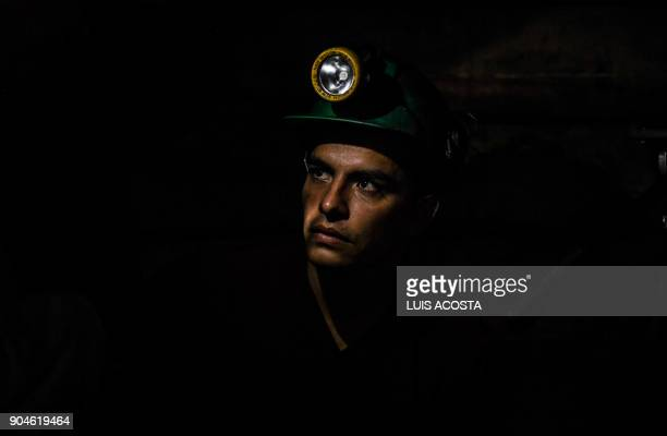 A miner works at an emerald mine in the municipality of Muzo known as the 'emerald capital of the world' in the Colombian department of Boyaca on...
