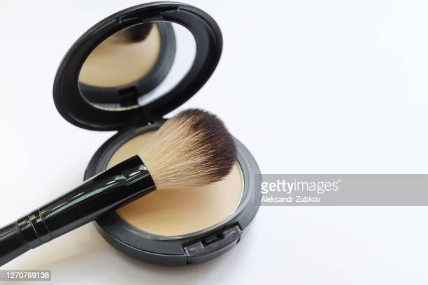 mineral compact powder with a brush for application, isolated on a white background. selective focus. - 白粉 ストックフォトと画像