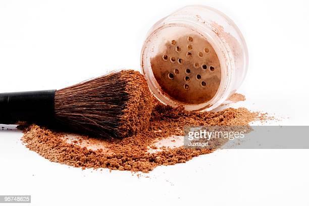 Mineral make-up jar spilled with brush