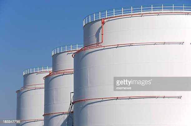 mineral oil storage tank farm - storage tank stock photos and pictures